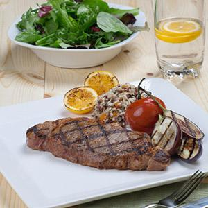 Peppered Strip Steaks with French Herb Cheese