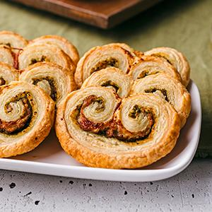 Prosciutto and Pesto Palmiers