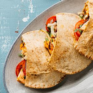Grilled Salmon Pitas with Yogurt Sauce and Tomato-Onion Salad