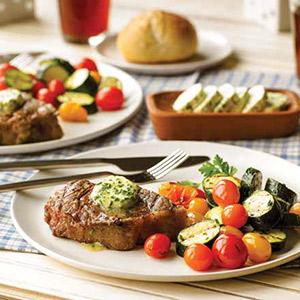 New York Strip Steaks with Horseradish, Lemon, and Chive Butter